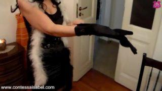 Leg teasing in black shiny minidress